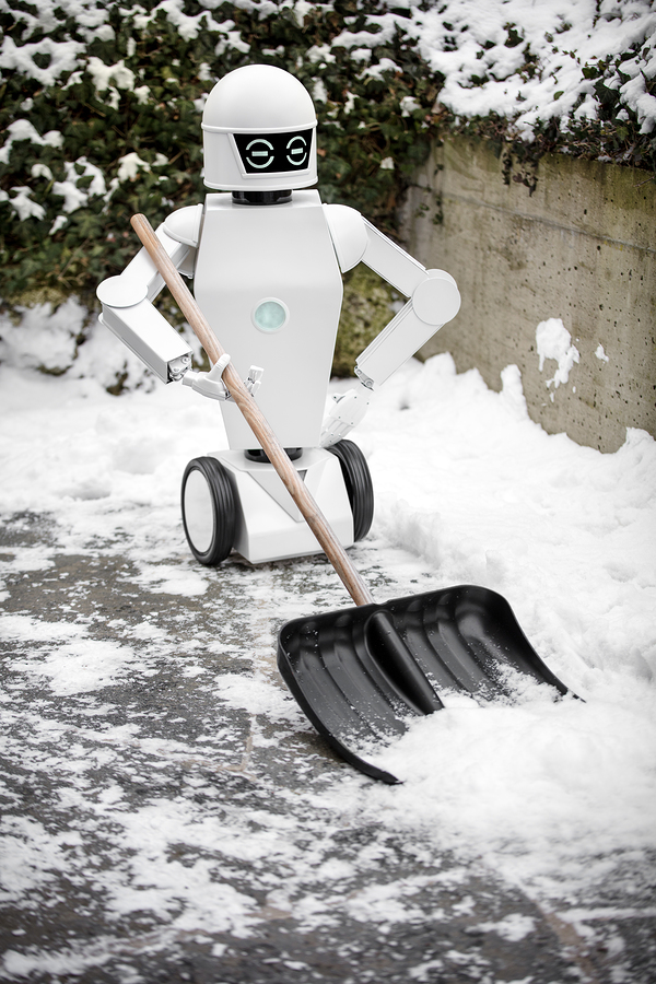 bigstock Service Robot Is Shovelling Sn 267608782